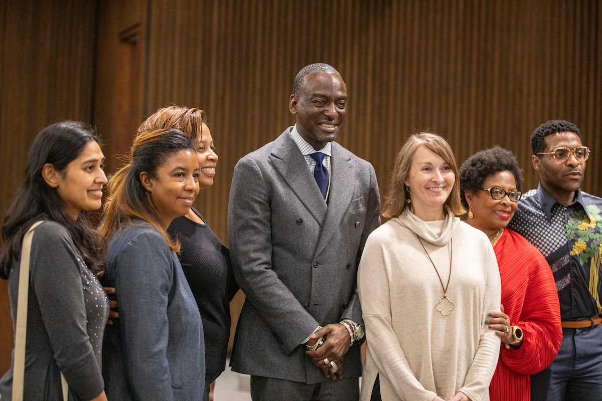 Yusel Salaam posing for photo with discussion participants
