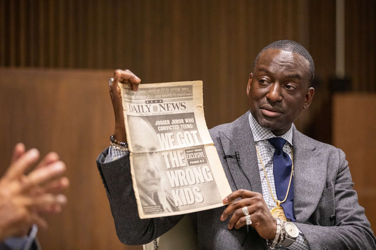 Salaam shares the cover of a newspaper noting a juror's comment after the men were exonerated
